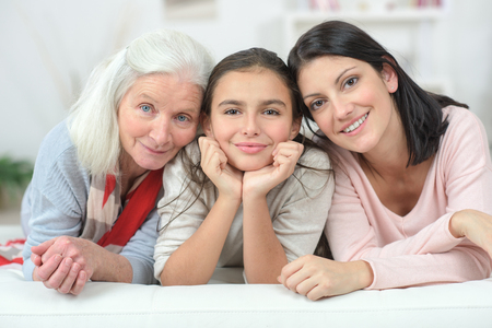 Three generations of women: grandmother, mother, and daughter. A strong community has all generations together.