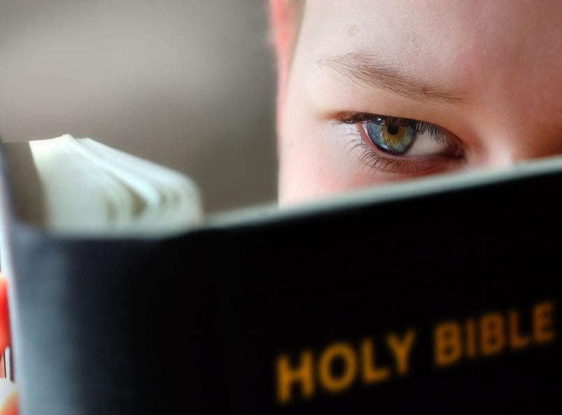 A child reading the Bible.