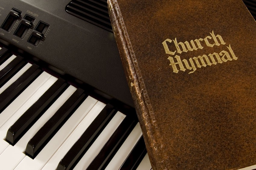 A hymnal on a piano. How can we make worship singing expansive, not exclusionary?