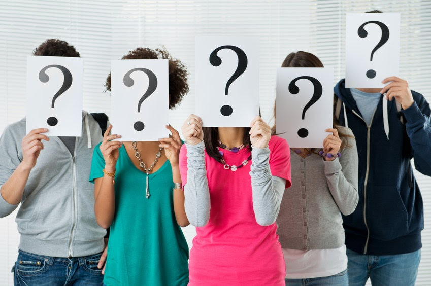 A group of people holding papers with question marks over their faces. In the Church, doubt is inevitable.