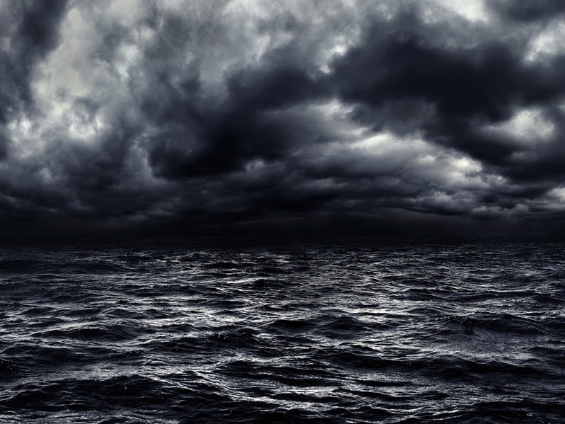 A black and white picture of the ocean during a storm. God created order out of the dark, watery chaos.