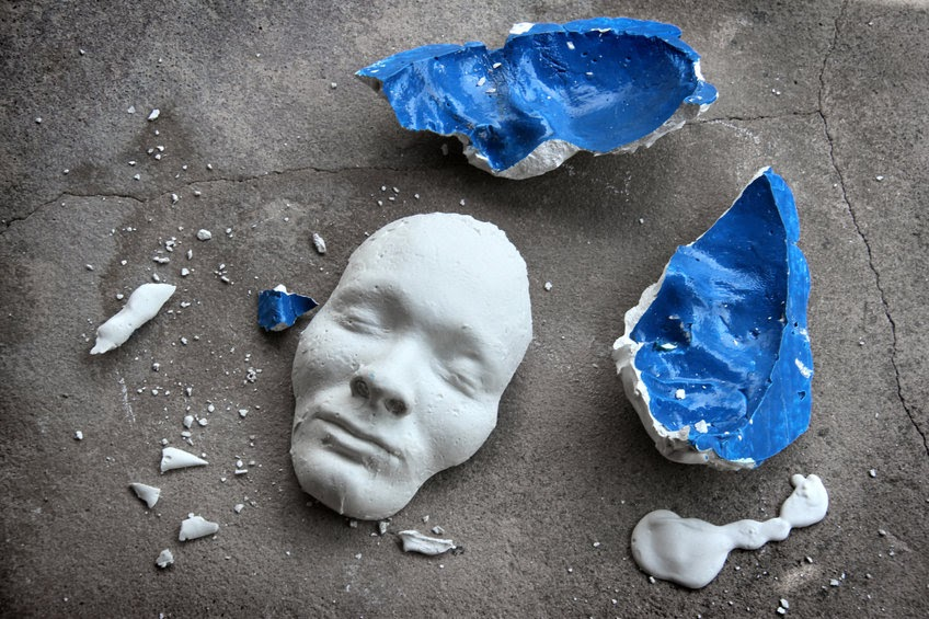 A broken clay mask. We sometimes try to hide our identity, but God knows and loves our whole selves.