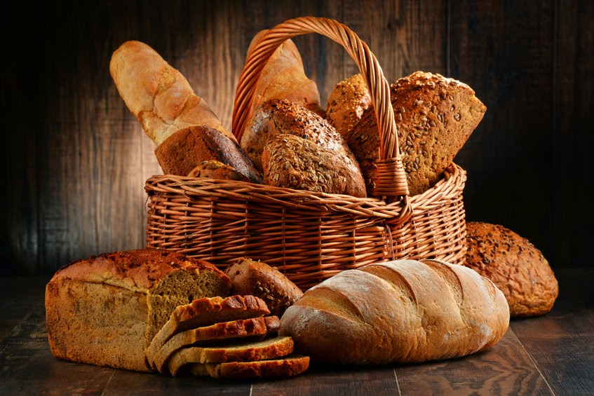 A basket full of different kinds of bread.